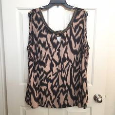 Tan & Black Print Top w/ Cutouts & Zipper Detail Cream/Tan & Black Print Top w/ Fun Cut Outs on back & Zipper Detail on Neckline. Plus size. Fun print design. Great for under a blazer for work or during a day out! Bellatrix Tops