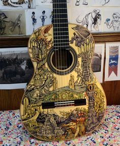I need to learn how to play guitar. Or i can decorate my own ukulele. I need to buy a ukulele. Guitar Painting, Guitar Art, Cool Guitar, Guitar Tattoo, Guitar Chords, Guitar Crafts, Ukulele Art, Lotr, Arte Sharpie
