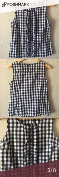 Odile gingham top Navy and white gingham ruffle neck top. Armpit to armpit is 18 inches, waist 17 and length is 22 1/2. Very good condition Odile Tops Tank Tops