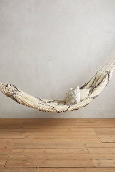 Can you imagine how comfortable this would be? Crossed Flokati Hammock - anthropologie.com