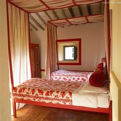 Wonderful red and white print in this rural Italian farmhouse which dates back over 300 years.