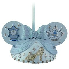 The hopeful Disney Princess brings her signature style to our Ear Hat Cinderella Ornament. Created by Disney artist Cody Reynolds, this detailed ornament features fairytale elements including sparkling rhinestone slipper and glittering bow. Disney Ears Hat, Mickey Mouse Ears Hat, Minnie Mouse, Disney Christmas Ornaments, Christmas Holidays, Christmas Tree, Christmas Stuff, Happy Holidays, Disney Holidays
