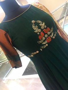 Gorgeous bottle green color floor length ananrkali dress with pair of birds with hand embroidery thread and kundan work on yoke.To order whatsapp 08 September 2018 Embroidery Suits Punjabi, Kurti Embroidery Design, Embroidery Dress, Embroidery Thread, Kurti Designs Party Wear, Kurta Designs, Saree Blouse Designs, Ethnic Wear Designer, Embroidered Clothes