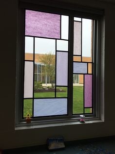 Faux stained glass using tissue paper and electricians tape. Middle school Windows.