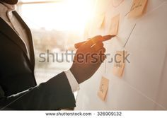 Cropped shot of businessman putting his ideas on white board during a presentation in conference room. Focus in hands with marker pen writing in flipchart. Marker Pen, Photo Editing, Royalty Free Stock Photos, Presentation, Illustration, Pictures, Image, Conference Room, Hands