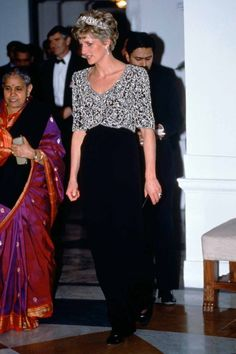 Princess Diana wearing a Catherine Walker dress during a visit in India.