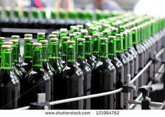 Photo about Detail of the bottling plant. Image of alcohol, industry, automated - 28216274 Packaging Machinery, Consumer Products, Getting Things Done, Art Pictures, Wine Rack, Productivity, Alcohol, Industrial, Clouds