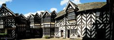 This is Little Moreton Hall in Cheshire, England. The first oak and wattle that hit the ground there was around 1504-1508 and construction continued with various extensions for another 100 years. More, including a Tudor gingerbread recipe from 1591, at www.naturalhomes.org/timeline/little-moreton-hall.htm