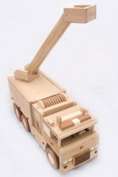 Wooden toys for children and adults. Made from wood of different breeds. Will question, write :) Dimensions: long-400mm, wide-195mm, tall-130mm or 15,7 long, 7,6 wide, 5,11 tall Made with love! Also, there are other wooden toys: Wooden helicopter https://www.etsy.com/ru/listing/497685506/wood-helicopter Wooden tractor trailer https://www.etsy.com/ru/listing/496206440/wooden-tractor-trailer Wooden racing car https://ww...