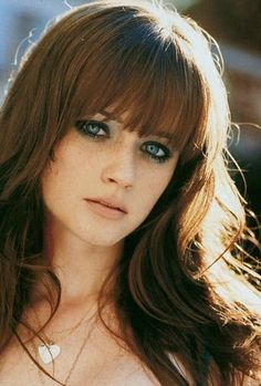 I gape at myself in the full-length mirror, not recognizing the vixen that stares  back at me. Kate has gone all out and played Barbie with me this evening, styling  my hair and makeup. My hair is full and straight, my eyes ringed with kohl, my lips scarlet red. I look . . . hot.   Alexis Bledel as Ana....