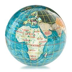 This is a gemstone globe:  you can see where the big things are (continents, cities), but the main function is that of a decorative touch.  This particular one is a gemstone paper weight  but other materials have also been used. (And have been, ever since the world was proved to be round).