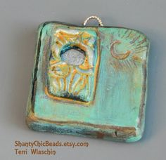 You can leave that opening as a window or add your own bead. by Terri Wlaschin
