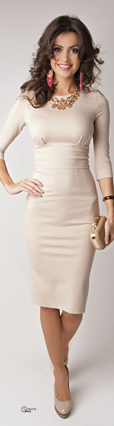 Fitted knee length dress. 3 quarter sleeves. Nude. Just without those earings