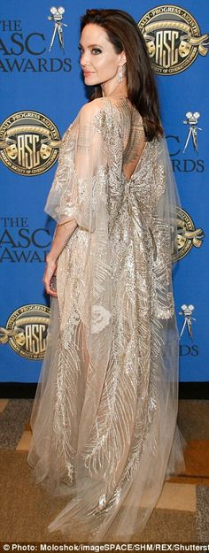 Magnificent: The trailing floor-length gown showcased the actress's sculpted arms and perf...