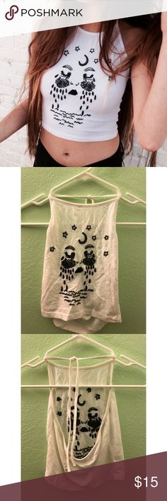 Brandy Melville Halter Top Brandy Melville embroidered Halter Top. Never worn or used but no tags Tops Crop Tops