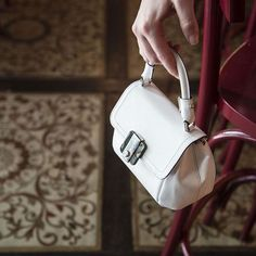 Luxury in white Gina Bag by Serapian Milano.  Photo by Tank Photo Factory