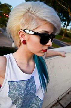 Shaved side turquoise /blond hair