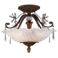Bring an elegant glimmer to your foyer, living room, or master bath with this lovely semi-flush mount, showcasing cut crystal accents and a bronze finish.  ...