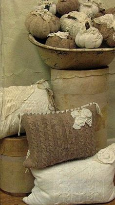 old sweaters for pillows, decorated with lace