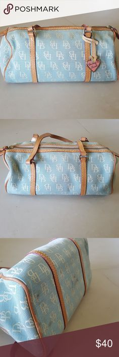 Dooney & Bourke Purse Baby blue D&B tote purse. Some wear to the bottom of the purse. Otherwise, great condition Dooney & Bourke Bags
