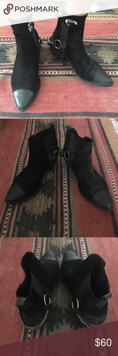 Black suede ankle boots w/ cowboy spur harness Love these but I bought them on here and they're a tad too tight on me. Probably best for an 8.5 or small 9. Real suede plus leather tips. Elastic on the sides so they're stretchy, but fit snug around the ankle. Heels and soles are in great condition. Tips have a few scuffs, but I think they're pre-distressed. Only minor flaw is the bottom of the spur/harness on the right shoe is a little scuffed, but it's definitely not noticeable when they're…