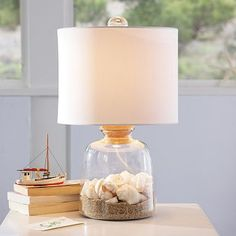 Loving this lamp. The photo does not do it justice. I've seen it in person and was thinking wine corks, love notes or random things like buttons would even be cute. The shells work for the summer though.