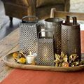 Place candles inside antique cheese graters for a rustic centerpiece and lighting option for your table.