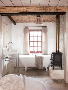 A wood burning stove by the bathtub?!  Oh yes!  All it's missing now is a flatscreen on the wall!  I'd never leave the tub!
