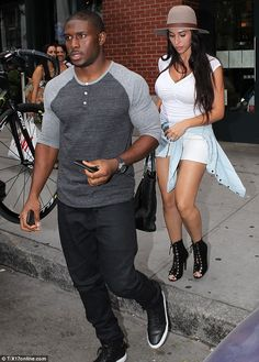 Kanye's hood: Football star Reggie Bush was seen with his wife Lilit Avagyan on Saturday a...