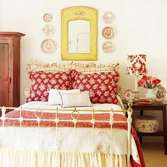 Red, white and yellow. Plates displayed on the wall with mirror. Loving everything about this room...