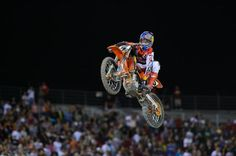 Ryan Dungey shifting his bent shift lever in mid-air with his hand. 2012 Monster Energy Cup
