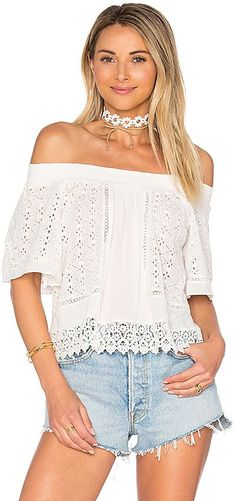 Lovers + Friends Seamist Top in Ivory. - size L (also in S,XS) Lovers + Friends Seamist Top in Ivory. - size L (also in S,XS) Exude flower child vibes in the Seamist Top designed by Lovers + Friends. An allover embroidered eyelet fabric gives this flowy off-the-shoulder top a dash of bohemian babin' charm.. Self: 100% cottonContrast: 100% viscose. Hand wash cold. Smocked elastic neckline. Embroidered eyelet fabric. Top features a true to size fit. LOVF-WS457. LFS16F0231. Constantly ins..