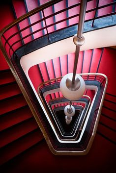 Art Deco stair case-stunning geometry and style with wrought iron balustrades and brass pendant lighting. Stairs And Staircase, Take The Stairs, Grand Staircase, Staircase Design, Spiral Staircases, Black Stairs, Amazing Architecture, Art And Architecture, Architecture Details