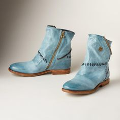 """TUMBLEWEED BOOTS--These patchwork boots blaze their own trail with pieced leather, whipstitching and zippered accents. Inside zippers. Imported. Euro whole sizes 36 to 41. 36 (US 6), 37 (US 7), 38 (US 8), 39 (US 9), 40 (US 10), 41 (US 10.5). 3/4"""" heel."""