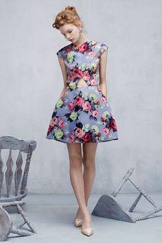 We love this Carven dress for its modern cutouts and romantic print!