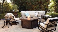 Love this curved sofa & the fire pit. Frontgate never disappoints.