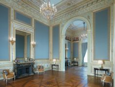 Salon de Famille--love the blue walls. The French know how to use color.