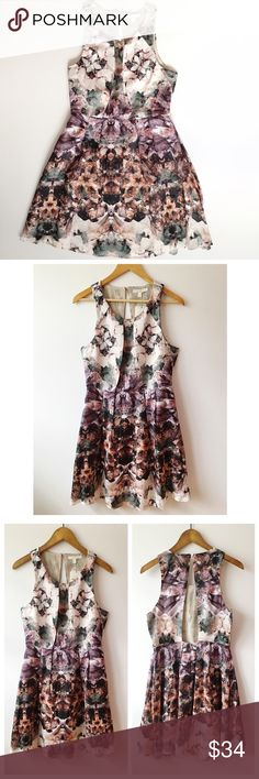 """Aryn K Open Back Floral Dress Aryn K at Anthropologie open back dress in a beautiful muted floral design. Cutout back with top button closure and pleated front.  Size medium- approx. 16.5"""" across bust, 36"""" long from shoulder to hem Size large- approx. 17.5"""" across bust, 36"""" long from shoulder to hem Anthropologie Dresses Midi"""