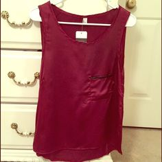 New Makiya burgundy pocket top Brand new with tags Makiya burgundy colored top with a pocket. One size but fits like a small/medium (sizes 4/6). Tops Blouses