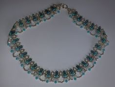 You can find this pattern in my book here: http://store.sandradhalpenny.com/crystal-lace-necklace-ebook-p318.php