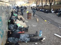 19.2.2014 Duncan Crawford ‏@_DuncanC Time for a nap. After the clashes riot police sleep on the streets around Independence Square