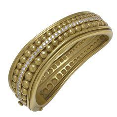 Kieselstein-Cord Diamond Gold Bracelet 1990s   From a unique collection of vintage cuff bracelets at https://www.1stdibs.com/jewelry/bracelets/cuff-bracelets/