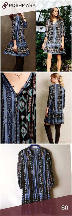 """Anthropologie Winter Moon Tunic Dress --- S/M Anthropologie Holding Horses Winter Moon Loose Fitting Tunic Dress --- size small --- runs large, will fit a medium --- 3/4 sleeves with elastic hem --- Black, blue, pink folklore print --- fringe ties at neck --- Ruffle hem --- bronze buttons --- Metallic thread --- Like new condition, slip not included --- Semi sheer, wear nude undergarments or a slip --- 20"""" bust 37"""" length  --- Rayon Crepe --- thank you for visiting my boutique, please feel…"""
