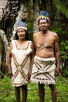 Huitoto chief and his wife , in the Amazon jungle of Peru. Tribe photo + traditional tribal dress. By travel photographer, portrait photographer and humanitarian photographer, Alicia Fox (Sydney, Australia).