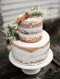 Naked cake with leather + floral topper
