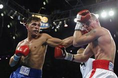 ATLANTIC CITY, NJ - NOVEMBER 23:  Arturo Gatti hits Mickey Ward with a left hook during their junior welterweight bout on November 23, 2002 ...