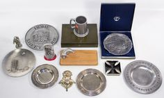 Lot 752: Pewter and Metalware Assortment; Including plates, an astronaut statue, a holy water font, a tankard and a cutting board
