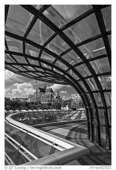 Curvy glass and metal structure framing historic Saint-Eustache church. Paris, France