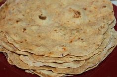 Homemade tortilla shells stacked and ready to be filled or frozen.