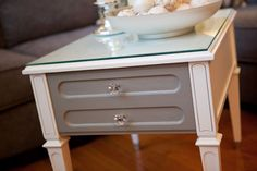 White vintage end table with crystal knob and pretty paper lining.  Love it!